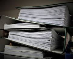 pile of court bundles for the article technological change long overdue in family law cases.