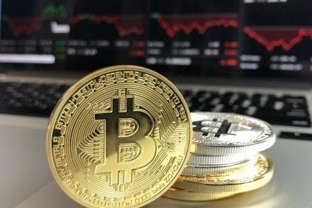 bitcoins hidden in divorce stacked in front of computer